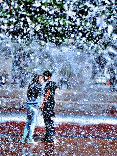 Young couple in the fountain on the Christian Science Plaza