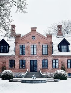 brick house with black trim-it is interesting and arresting visually.