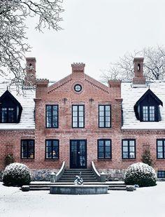 Stately brick house with black trim