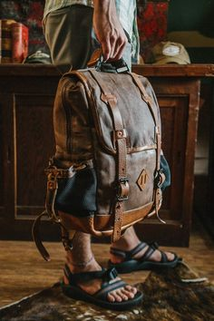 Dakota Vintage Commuter Backpack - Waxed Canvas & Leather - Saddle Tan: Crafted of waxed canvas and distressed leather, this vintage commuter backpack was built to honor the memory of good men and good days. Made with the most durable of canvases, leather accents, and plenty of room for all your work, sport, or travel products. Fill it with all you need for work or a day's travel.