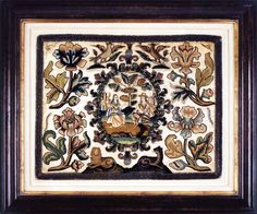 Cartouche with Couple in Landscape. A brightly coloured embroidery with a central raised work cartouche  centrally positioned and placed above two royal beasts.  Oversized plant slips applied to all four corners. Worked in floss silks. English. Circa 1660 Witney Antiques