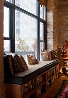 A bench seat at the window in the living and dining area. Ben Sklar for the NYT
