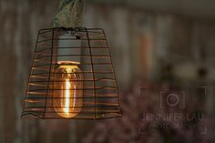 A light I fashioned from a vintage zinc wire basket. Finished it off with a filiment bulb. Available at The Firefly Artists, Northport, NY
