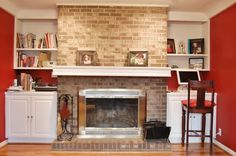 Amazing Stone Fireplace Designs With Mantels : Brick Wall Fireplace With Large White Colored Mantel And White Wall Shelf Along With Transparent Glass Fireplace Screens And White Cabinets Along With Red Wall Paint Color