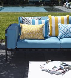 Mixing vibrant colours and patterns to energise your outdoor space with Warwick's Sundec collection of outdoor fabrics #warwickfabricsuk #outdoor #poolside #textiles #geometric #stripes #cushions #upholstery #sundec