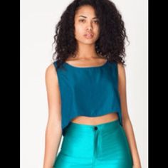 American Apparel High Waisted Shorts Brand new with tags. Green high waisted shorts from American Apparel. Size XS  Pair with a body suit and heels or converse and crop t shirt. Dress up or down.. American Apparel Shorts