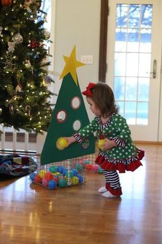 Your toddlers will adore this festive sorting game made out of cardboard, poster board, a yardstick, zip ties, construction paper, ball pit balls, and a basket.