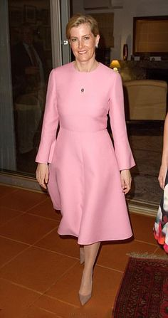 Sophie, Countess of Wessex looked radiant in a long-sleeved rose-pink dress which she teamed with pale pink kitten heels during her visit to the East African nation on March 14, 2017