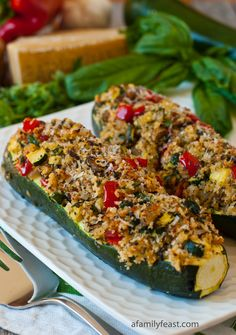 Vegetarian Stuffed Zucchini - I'm thinking black beans or lima beans instead of mushrooms and red quinoa instead of bread crumbs.