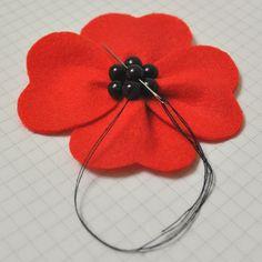 Make a red poppy felt brooch guidecentral Handmade Felt, Handmade Flowers, Felt Flowers, Fabric Flowers, Poppy Wreath, Poppy Pattern, Red Pattern, Poppy Brooches, Felting Tutorials