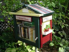 love the window box on this little front yard free library!