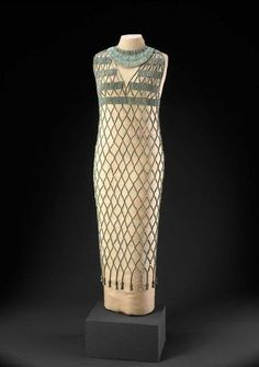 Beadnet Dress ~ Museum of Fine Arts, Boston ~ B. From the Old Egyptian Kingdom in Dynasty This beadnet dress is constructed of faience cylinder beads and 27 faience floral pendants reconstructed by Sheila Shear in Ancient Egyptian Clothing, Egyptian Fashion, Egyptian Women, Historical Costume, Historical Clothing, Historical Dress, Egyptian Costume, Vintage Outfits, Vintage Fashion