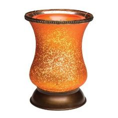 Gold Tulip Shade Scentsy Warmer - The sultriness of antique boudoir lanterns has inspired the design of our new Gold Tulip Shade Scentsy Warmers. A seductively curved form sensually displays the glowing amber finish, rimmed with bronze bands of delicately detailed metal work.  www.karenburnett.scentsy.us