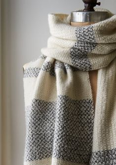 Inspired by vintage tea towels, the Peppered Stripes Wrap is a free knitted scarf pattern with a classic striped blue colorwork pattern.