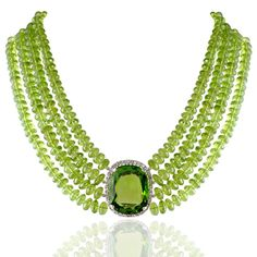 Peridot and diamond choker, the four rows of faceted peridot beads to the 59.03cts cushion-shaped peridot and diamond cluster centre