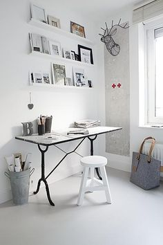 Cool vintage bistro table turn into a desk. I love it.