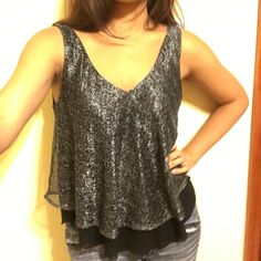 Flowy Black and Silver Sparkle Tank black tank with silver sparkle overlay, flowy material that drapes beautifully and moves with you on the dance floor, re-posh that I impulse bought when I already have too many going out tanks, seller sent it in amazing condition! Express Tops Tank Tops