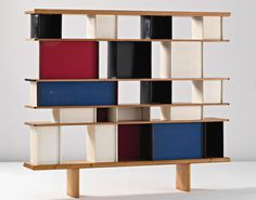 Bookcase from the maison du Mexique. Design by Charlotte Perriand, Sonia Delaunay, and Jean Prouvé.