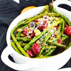Pan Sauteed Asparagus with fresh tart cranberries, toasted pine nuts, zested citrus and grated Parmesan cheese make a beautiful and scrumptious holiday side dish.