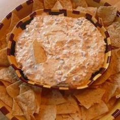 Cheesy Sour Cream and Salsa Dip Recipe.  I've made this a few times, easy party dip