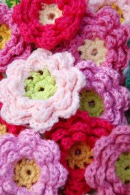 Crocheted flower tutorial. This is my go to flower pattern.