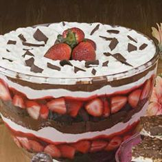 1 package (18-1/4 ounces) chocolate cake mix 1 quart fresh whole strawberries 1 carton (15 ounces) strawberry glaze 2 cartons (12 ounces each) frozen whipped topping, thawed, divided 1 cup chocolate frosting Shaved chocolate
