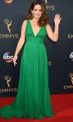 TINA FEY wears an emerald Oscar de la Renta gown with actual emeralds (100 carats of them) from Lorraine Schwartz.