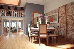 Christian Siriano's NYC apartment. Rustic brick wall, tomato label painting.