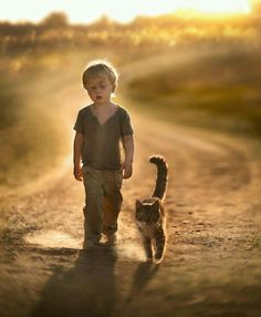 A young boy and his cat...