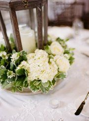Green and white centerpiece with lantern