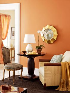 Bold Orange - paint inside bookshelves a contrasting color, update lamp...would go perfect with new wood floors
