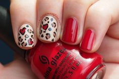 Leopard hearts from Kelsie's Nail Files. (That red is China Glaze Adventure Red-Y.)