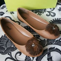 Capelli Tan  flats New never used. Faux leather Flat with feather & rhinestone trim Capelli Shoes Flats & Loafers