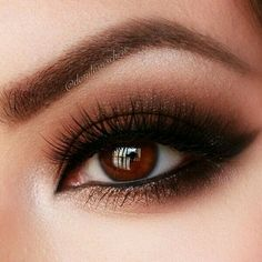 beautiful neutral brown smokey eye with gold accent on bottom lashline.