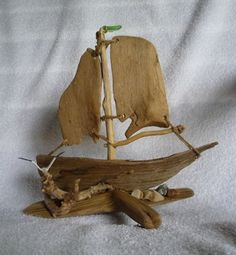 Driftwood Sailboat.  I love the sea glass mast flag and the fact that the sails are driftwood instead of cloth.  I found this at http://www.artfire.com/users/Ginnysart