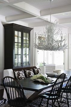Love the black chairs with a black cabinet - would really show off Mom's china of white and gray.