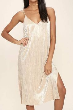 PLEATED GOLD FOIL DRESS  Holiday dress that is sure to shine at any party. Simple strap top, v cut front and back and slits on the bottom. COMMON LA