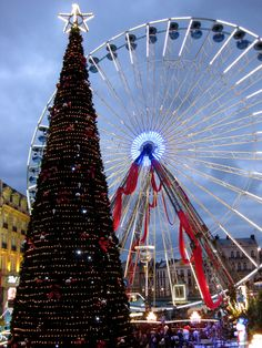 """photoencounters: """" Ferris wheel, Lille Christmas Market. Lille, France. Photo by Amber Maitrejean """" The first time I ever visited a Christmas market. I walked around like a first time visitor to..."""