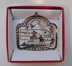 COLLECT THEM EVERYWHERE YOU'VE TRAVELED OR LIVED - NICE MEMORIES WHEN YOU HANG THEM ON THE TREE EACH YEAR!Nebraska State Brass Christmas ORNAMENT Souvenir Gift Omaha Lincoln Sand Hills Nations Treasures http://www.amazon.com/dp/B00FTCTW26/ref=cm_sw_r_pi_dp_owJGub0WYVJHE