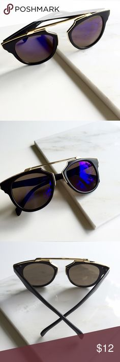 "So Real Black Blue Mirrored Cat Eye Sunglasses So cute, so fun. Get the So Real look without the price. Black Shiny frames with blue mirrored lenses and gold metal accents and brow bar. 100% UV protection. 5.8"" W x 2.1"" H. Available 4 other colors. Price is firm unless bundled. Bundle 4 or more and save 20%. Accessories Sunglasses"