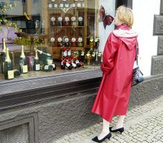 Window shopping dressed in her red klepper coat