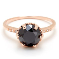 8mm black diamond center (~2.5ct) with small white diamond accents in 14kt rose gold, $5,000.00.
