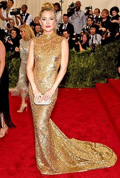 Kate Hudson-in a custom, suntan-hued stretch tulle Michael Kors dress with an open back and hand-embroidered paillettes
