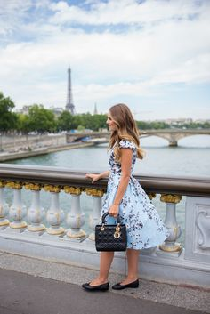 dbae14b20e73 Wearing my Lela Rose dress and carrying my Chanel bag in Paris Girl Meets  Glam