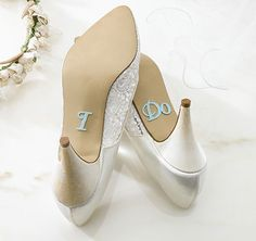 "Decorate the bride's shoe soles with this pair of blue glitter stickers that spells ""I Do."""