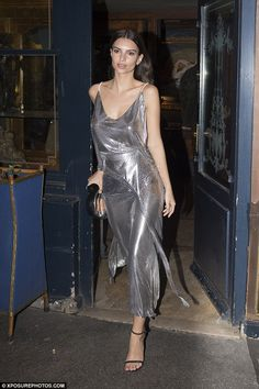 Stunning in silver: Emily Ratajkowski sported one of her most standout looks to date when she stepped out for the V magazine bash during Paris Fashion Week on Tuesday
