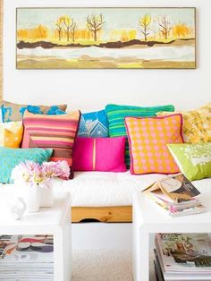 How to accessorize your white living space with pops of vibrant color.