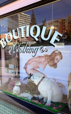 Pinup window with lobster at Bow Wow Beauty Shoppe in San Diego, CA. Http://www.bowwowbeautyshoppe.com #pet boutique, #boutique for dogs #dog boutique