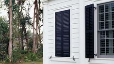 Just Fake It - Stylish Window Shutters - Southern Living - Guess what's behind these closed shutters? (Hint: It's not a window.) Shutters can be fixed inside a false opening to help achieve symmetry on a home's exterior. Exterior Siding Colors, Exterior Gray Paint, Exterior House Siding, Exterior Front Doors, Outdoor Window Shutters, Farmhouse Shutters, Painting Shutters, Exterior Light Fixtures, Farm House Colors