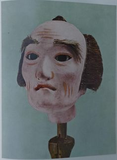 Another colorplate from Masterpieces of Japanese Puppetry. Sculptured Heads of the Bunraku Theater by Saito Seijiro.